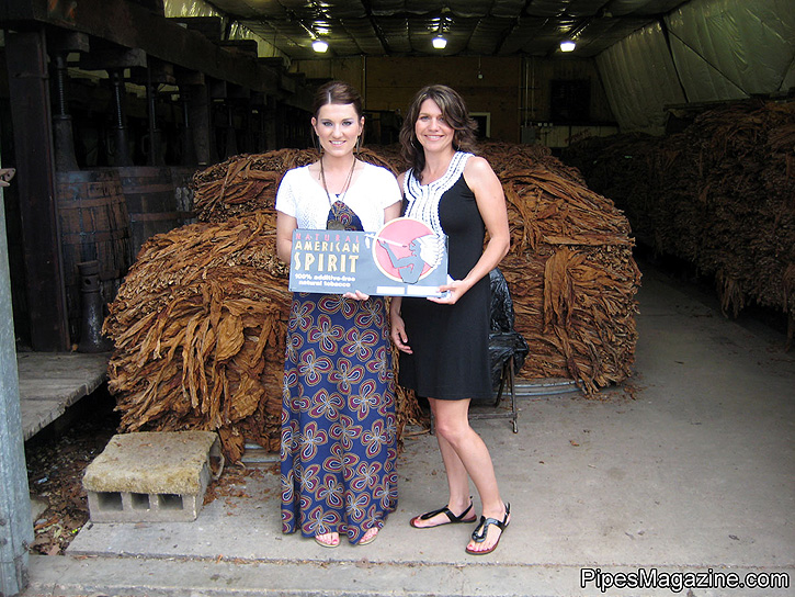 American Spirit Reps, Rami Bourgeois & Kim Trahan at the L.A. Poche Factory. In the background are Perique Bales waiting to be destemmed and processed for aging and fermenting.