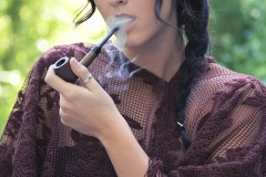 Gina Roode Smoking a Pipe in the Forest