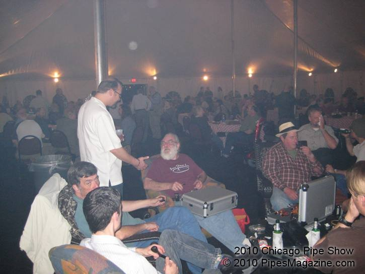 Kevin (standing) talking with Bob Gilbert, Pipe Maker in the Smoking Tent