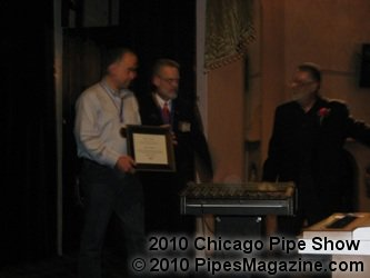 Fred Hanna Receives His Award from Mike and Frank