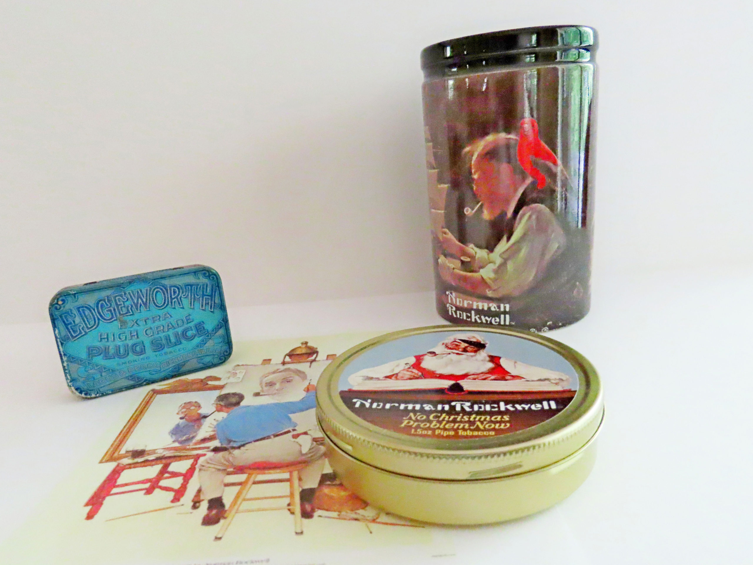 """Norman Rockwell """"No Christmas Problem Now"""" Tobacco & """"For a Good Boy"""" Ceramic Jar, along with Edgeworth, which he seemingly smoked."""